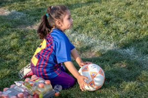 Young girl with soccer ball.